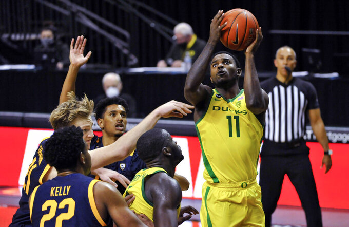 Oregon guard Amauri Hardy (11) shoots during the second half of the team's NCAA college basketball game against California on Thursday, Dec. 31, 2020, in Eugene, Ore. (AP Photo/Andy Nelson)