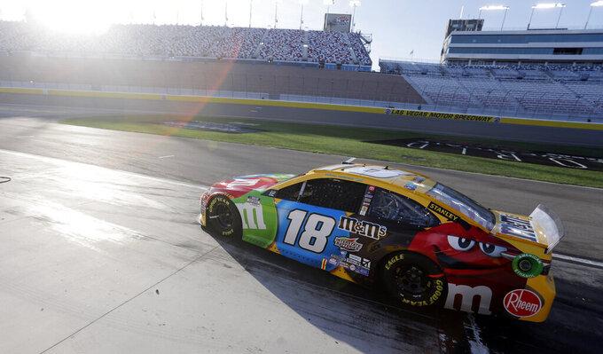 Kyle Busch exits the pits during a NASCAR Cup Series auto race Sunday, Sept. 27, 2020, in Las Vegas. (AP Photo/Isaac Brekken)