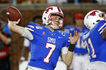 FILE - In this Oct. 5, 2019, file photo, SMU quarterback Shane Buechele throws a pass during the first half of an NCAA college football game against Tulsa, in Dallas, Texas. Buechele is the starting quarterback for an undefeated Top 25 team, like so many people envisioned when he started 12 games as a true freshman for Texas. Except Buechele is now close to home after going to No. 19 SMU as a graduate transfer. (AP Photo/Roger Steinman, File)