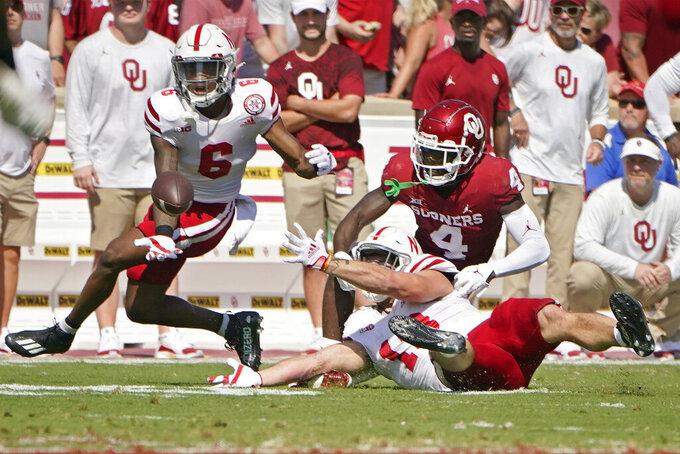 Nebraska cornerback Quinton Newsome (6) and linebacker JoJo Domann, right, break up a pass intended for Oklahoma wide receiver Mario Williams (4) in the first half an NCAA college football game, Saturday, Sept. 18, 2021, in Norman, Okla. (AP Photo/Sue Ogrocki)