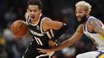 Atlanta Hawks guard Trae Young (11) drives against Golden State Warriors guard Ky Bowman (12) in the first half of an NBA basketball game Monday, Dec. 2, 2019, in Atlanta. (AP Photo/John Bazemore)