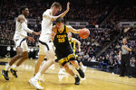 Iowa center Luka Garza (55) drives on Purdue center Matt Haarms (32) during the first half of an NCAA college basketball game in West Lafayette, Ind., Wednesday, Feb. 5, 2020. (AP Photo/Michael Conroy)
