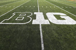 FILE - In this Aug. 31, 2019, file photo, the Big Ten logo is displayed on the field before an NCAA college football game between Iowa and Miami of Ohio in Iowa City, Iowa. The Big Ten released its 10-game conference-only football schedule beginning as early as Labor Day weekend but cautioned there is no certainty games will be played. (AP Photo/Charlie Neibergall, File)