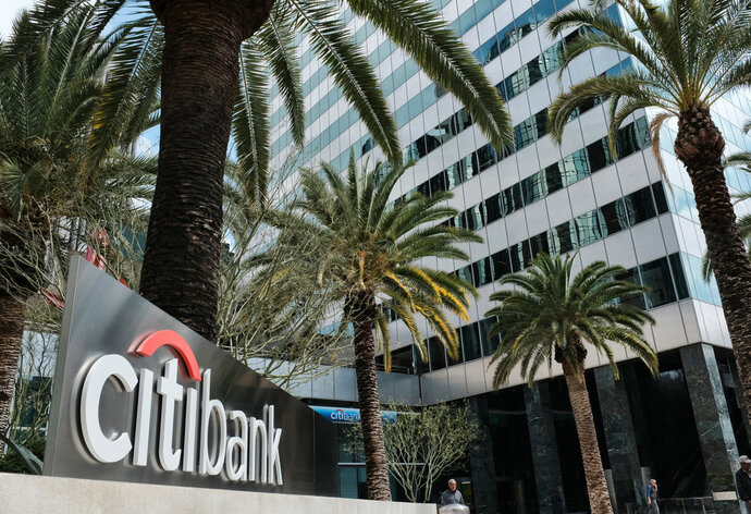 FILE- This March 23, 2018, file photo shows the entrance to Citibank at the Citigroup Center in downtown Los Angeles. Citigroup reports earnings Friday, April 13, 2018. (AP Photo/Richard Vogel, File)