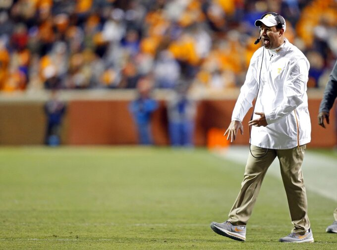 Tennessee head coach Jeremy Pruitt yells to his players in the second half of an NCAA college football game against Kentucky Saturday, Nov. 10, 2018, in Knoxville, Tenn. Tennessee won 24-7. (AP Photo/Wade Payne)