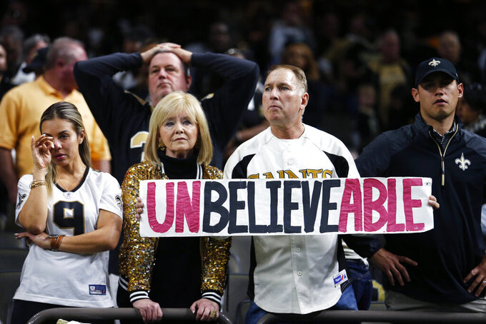 New Orleans Saints fans react after their overtime loss to the Minnesota Vikings in an NFL wild-card playoff football game, Sunday, Jan. 5, 2020, in New Orleans. The Vikings won 26-20. (AP Photo/Brett Duke)