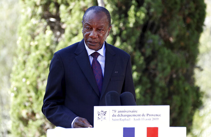 FILE - In this Thursday, Aug. 15, 2019 file photo, Guinean President Alpha Conde delivers a speech during a ceremony marking the 75th anniversary of the WWII Allied landings in Provence, in Saint-Raphael, southern France. Witnesses say heavy gunfire has erupted near the presidential palace in Guinea's capital and went on for hours. It was not immediately known whether President Alpha Conde was home at the time the shooting began. But the gunfire prompted security concerns in the West African country with a long history of coup attempts.  (Eric Gaillard/Pool Photo via AP, File)