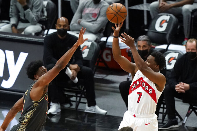 Toronto Raptors guard Kyle Lowry, right, shoots against Chicago Bulls forward Thaddeus Young during the first half of an NBA basketball game in Chicago, Sunday, March 14, 2021. (AP Photo/Nam Y. Huh)