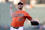 Baltimore Orioles starting pitcher Dylan Bundy throws a pitch to a Toronto Blue Jays batter during the first inning of a baseball game, Saturday, Aug. 3, 2019, in Baltimore. (AP Photo/Julio Cortez)