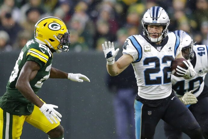 FILE - In this Nov. 10, 2019, file photo, Carolina Panthers' Christian McCaffrey (22) runs during the first half of an NFL football game against the Green Bay Packers in Green Bay, Wis. McCaffrey is on a record pace even as his team struggles, putting him in high on the list of AP MVP candidates. (AP Photo/Jeffrey Phelps, File)