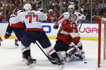 Florida Panthers goaltender Sergei Bobrovsky (72) looks back as Washington Capitals right wing T.J. Oshie (77) and center Nicklas Backstrom, right, react to a goal scored by Washington Capitals left wing Alex Ovechkin during the second period of an an NHL hockey game, Thursday, Nov. 7, 2019, in Sunrise, Fla. (AP Photo/Lynne Sladky)