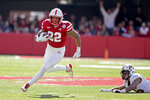 Nebraska running back Devine Ozigbo (22) runs for a touchdown past a tackle-attempt by Minnesota defensive back Coney Durr (16) during the first half of an NCAA college football game in Lincoln, Neb., Saturday, Oct. 20, 2018. (AP Photo/Nati Harnik)