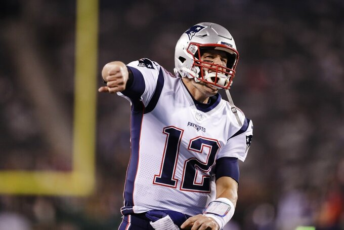 New England Patriots quarterback Tom Brady reacts to the crowd before an NFL football game against the New York Jets, Monday, Oct. 21, 2019, in East Rutherford, N.J. (AP Photo/Adam Hunger)