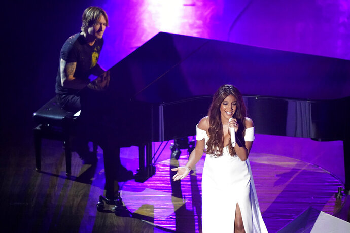 Mickey Guyton, right, and Keith Urban perform