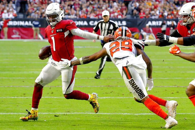 Arizona Cardinals quarterback Kyler Murray (1) eludes Cleveland Browns defensive back Sheldrick Redwine (29) during the first half of an NFL football game, Sunday, Dec. 15, 2019, in Glendale, Ariz. (AP Photo/Rick Scuteri)