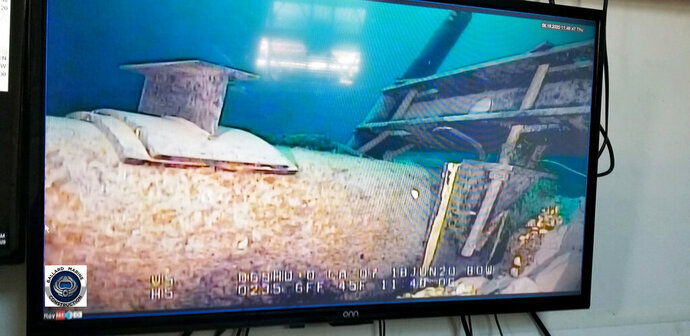 FILE - This June 2020, file photo, shot from a television screen provided by the Michigan Department of Environment, Great Lakes, and Energy shows damage to anchor support EP-17-1 on the east leg of the Enbridge Line 5 pipeline within the Straits of Mackinac in Michigan. Enbridge's plans for drilling an oil pipeline tunnel beneath a channel linking two of the Great Lakes do not meet industry standards and pose significant hazards to workers and the environment, experts who reviewed project documents on behalf of opposition groups told The Associated Press.(Michigan Department of Environment, Great Lakes, and Energy via AP, File)
