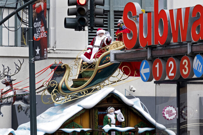 A float carrying the characters Santa Claus and Mrs. Claus rolls along at it nears the end of the modified Macy's Thanksgiving Day Parade Thursday, Nov. 26, 2020, in New York. Due to the pandemic, crowds of onlookers were not allowed to attend the annual parade. (AP Photo/Craig Ruttle)