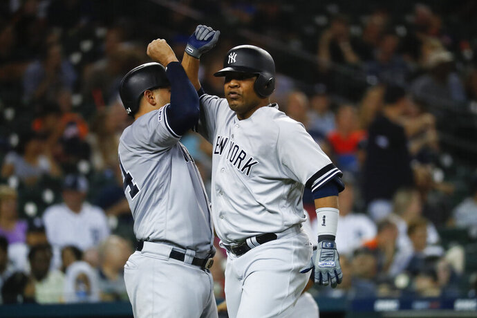 New York Yankees' Edwin Encarnacion, right, celebrates his two-run home run with New York Yankees Gary Sanchez in the seventh inning of a baseball game against the Detroit Tigers in Detroit, Tuesday, Sept. 10, 2019. (AP Photo/Paul Sancya)