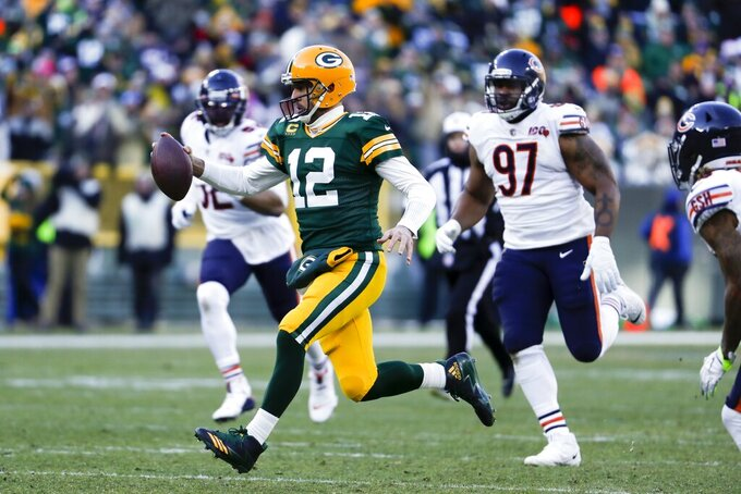 Green Bay Packers' Aaron Rodgers runs for a first down during the second half of an NFL football game against the Chicago Bears Sunday, Dec. 15, 2019, in Green Bay, Wis. (AP Photo/Matt Ludtke)