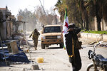 Turkish backed Syrian rebels enter the own of Saraqeb, in Idlib province, Syria, Thursday, Feb. 27, 2020. Turkey-backed Syrian opposition fighters Thursday retook a strategic northwestern town iof Saraqeb, opposition activists said, and cut off the key highway linking the capital, Damascus, with the northern city of Aleppo, days after the government reopened it for the first time since 2012. (AP Photo/Ghaith Alsayed)