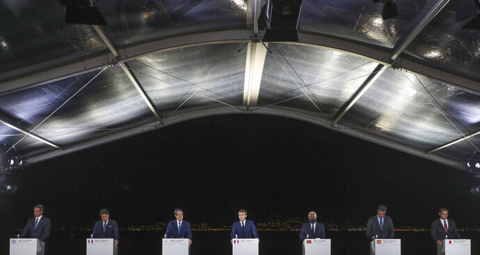 From left to right, Greek Prime Minister Kyriakos Mitsotakis, Italy's Prime Minister Giuseppe Conte, Cyprus President Nikos Anastasiadis, France's President Emmanuel Macron, Portugal's Prime Minister Antonio Costa, Spain's Prime Minister Pedro Sanchez and Malta's Prime Minister Robert Abela , attend a media conference after an emergency summit in Porticcio, Corsica island, Thursday Sept.10, 2020. Leaders of EU countries on the Mediterranean Sea are holding an emergency summit in Corsica on Thursday amid fears of open conflict with Turkey stemming from mounting tensions over oil and gas drilling. (Ludovic Marin/Pool Photo via AP)