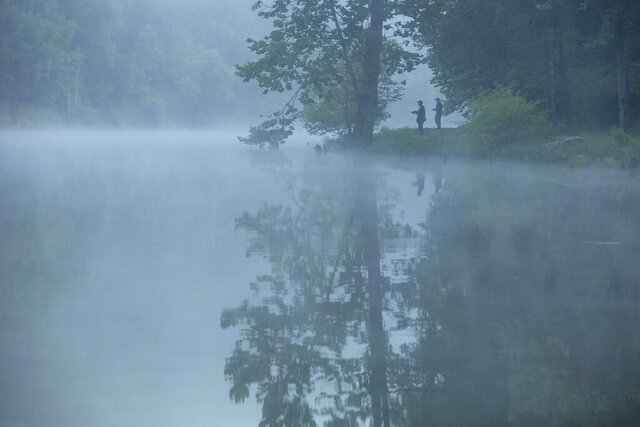 This July 26, 2019 photo provided by The Nature Conservancy shows two people fishing in the mist and fog over the Clinch River as seen from the Clinch Riverwalk on Sugar Hill property in St. Paul, Va. The Cumberland Forest Project protects 253,000 acres of Appalachian forest in Tennessee, Kentucky, and Virginia and is one of TNC's largest-ever conservation efforts in the eastern United States. (Travis Dove/The Nature Conservancy via AP)