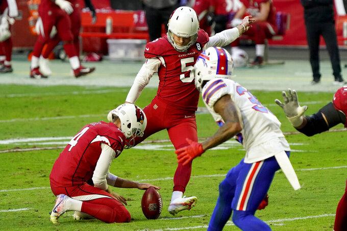 Arizona Cardinals kicker Zane Gonzalez (5) kicks a field goal as punter Andy Lee (4) holds during the first half of an NFL football game against the Buffalo Bills, Sunday, Nov. 15, 2020, in Glendale, Ariz. (AP Photo/Rick Scuteri)