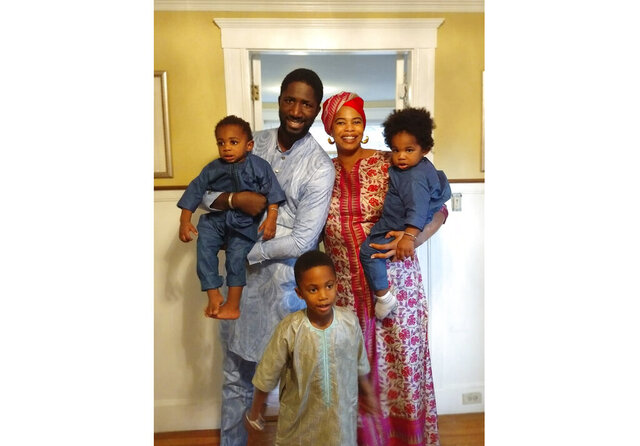 This 2019 photo shows Bouba Diemé with his wife, Désirée Allen, their 5-year-old son, Buraq Abdou, center, and twin 1-year-olds, Sembène Khalifa, held by Diemé, and Sankara Kokà. Diemé said the family's isolation during lockdown due to the coronavirus pandemic has taught him to be more patient with his children. (Dieynaba Diemé via AP).