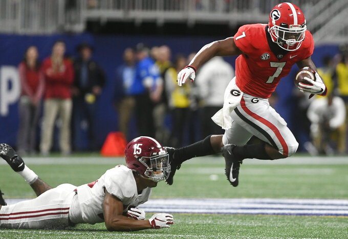 Georgia running back D'Andre Swift (7) runs against Alabama defensive back Xavier McKinney (15) during the first half of the Southeastern Conference championship NCAA college football game, Saturday, Dec. 1, 2018, in Atlanta. (AP Photo/John Amis)