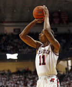 Texas Tech's Tariq Owens shoots during the first half of the team's NCAA college basketball game against Kansas, Saturday, Feb. 23, 2019, in Lubbock, Texas. (AP Photo/Brad Tollefson)