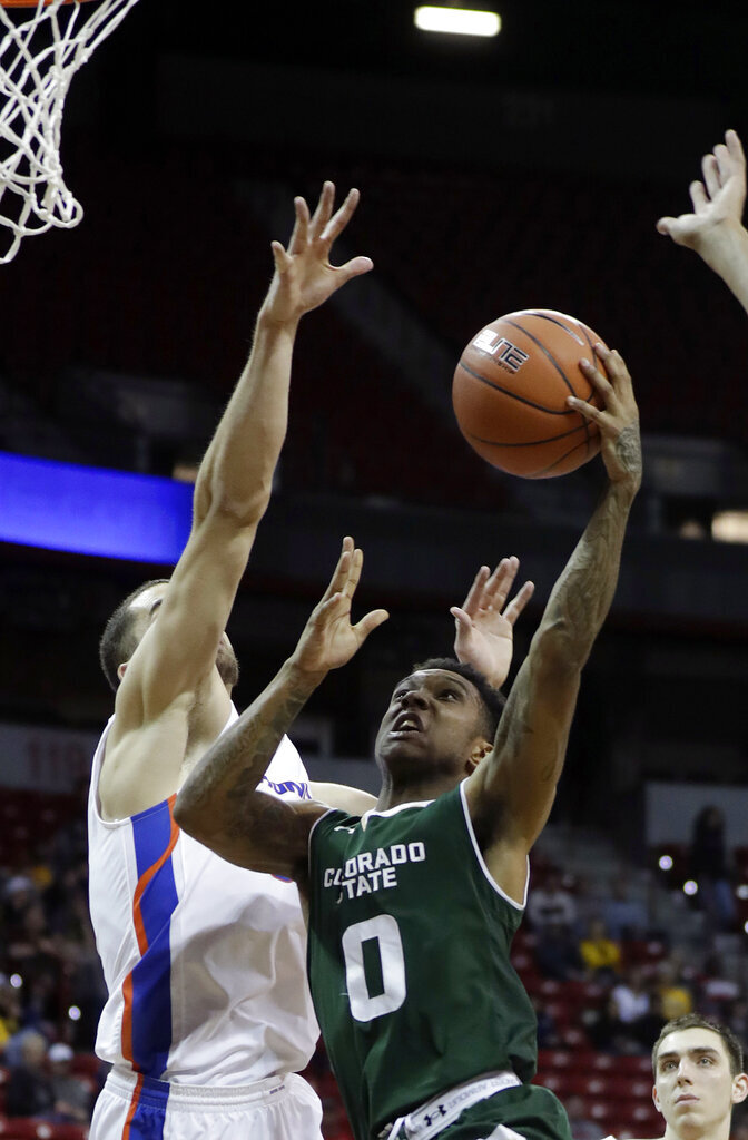Colorado State's Hyron Edwards (0) shoots as Boise State's David Wacker defends during the second half of an NCAA college basketball game in the Mountain West Conference tournament, Wednesday, March 13, 2019, in Las Vegas. (AP Photo/Isaac Brekken)