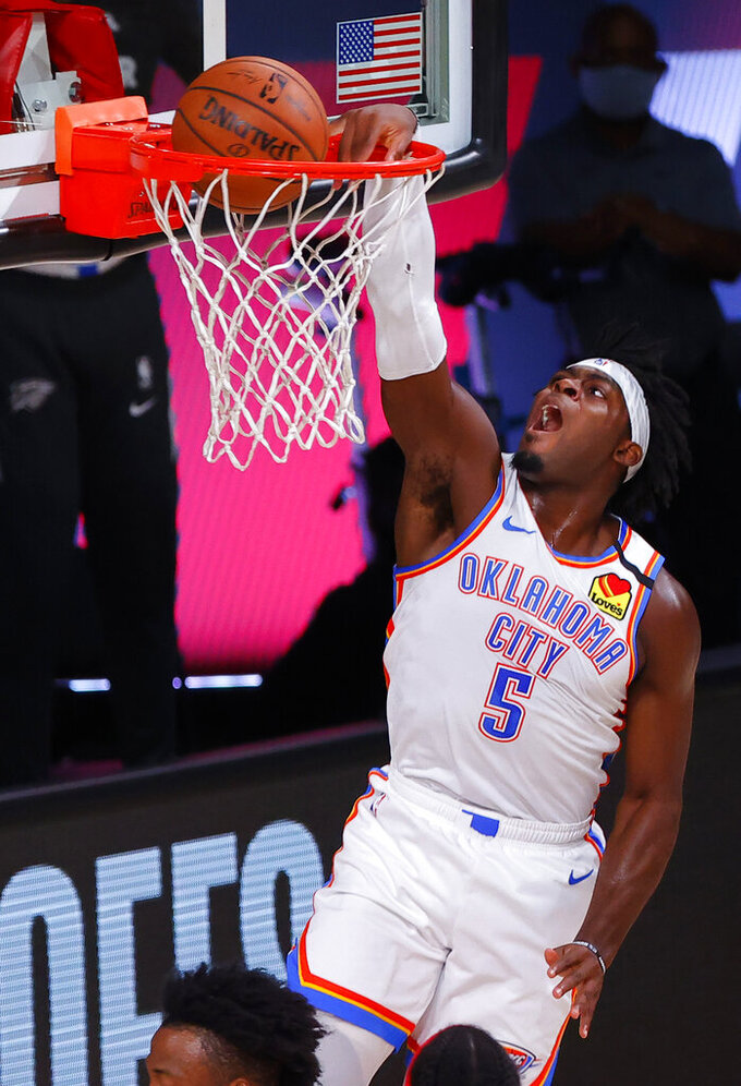 FILE - Oklahoma City Thunder's Luguentz Dort (5) dunks against the Houston Rockets during the first quarter of Game 4 of an NBA basketball first-round playoff series in Lake Buena Vista, Fla., in this Monday, Aug. 24, 2020, file photo. The young guys who emerged for the Oklahoma City Thunder last season will have more responsibility now that veterans Chris Paul, Steven Adams and Danilo Gallinari have moved on. (Kevin C. Cox/Pool Photo via AP, File)