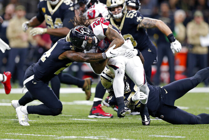 New Orleans Saints strong safety Vonn Bell (24) tries to tackle Atlanta Falcons running back Devonta Freeman (24) in the first half of an NFL football game in New Orleans, Sunday, Nov. 10, 2019. (AP Photo/Rusty Costanza)
