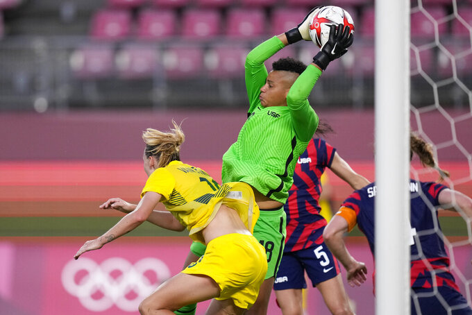 United States' goalkeeper Adrianna Franch intercepts a shot challenged by Australia's Emily Van Egmond in the women's bronze medal soccer match at the 2020 Summer Olympics, Thursday, Aug. 5, 2021, in Kashima, Japon. (AP Photo/Andre Penner)