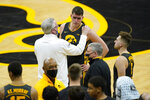 Iowa head coach Fran McCaffery, left, talks with center Luka Garza, center, and guard Jordan Bohannon, right, after an NCAA college basketball game against Wisconsin, Sunday, March 7, 2021, in Iowa City, Iowa. Garza, a senior, was playing his last home game at Iowa. Iowa won 77-73. (AP Photo/Charlie Neibergall)
