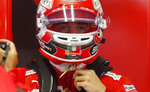 Ferrari driver Charles Leclerc of Monaco stands at the pit during the first free practice at the Monza racetrack, in Monza, Italy, Friday, Sept. 6, 2019. The Formula one race will be held on Sunday. (AP Photo/Antonio Calanni)