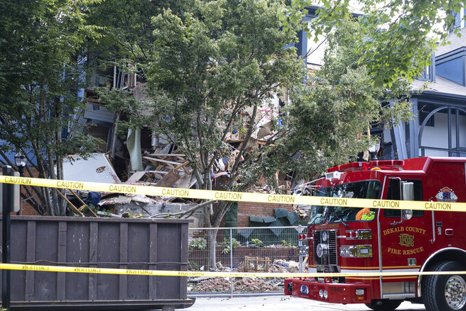 An apartment building sits damaged Monday Sept. 13, 2021 in Dunwoody, Ga., just outside of Atlanta, following an explosion Sunday. (AP Photo/Ben Gray)