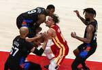 Atlanta Hawks' Trae Young (11) guards the ball against the New York Knicks during the first half in Game 3 of an NBA basketball first-round playoff series Friday, May 28, 2021, in Atlanta. (AP Photo/Brynn Anderson)