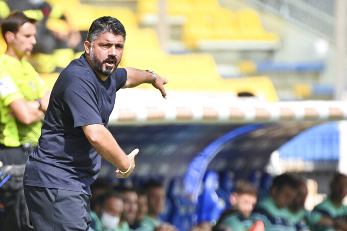 Napoli's coach Gennaro Gattuso gives directions to his players during the Serie A soccer match between Parma and Napoli at the Ennio Tardini stadium in Parma Sunday, Sept. 20, 2020. (Massimo Paolone/LaPresse via AP)