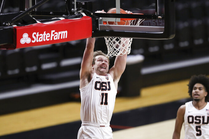 Oregon State's Zach Reichle (11) dunks against Colorado during the first half of an NCAA college basketball game in Corvallis, Ore., Saturday, Feb. 20, 2021. (AP Photo/Amanda Loman)