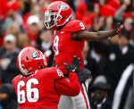 Georgia wide receiver Jeremiah Holloman (9) celebrates with offensive lineman Solomon Kindley (66) after scoring touchdown against Georgia Tech in the first half of an NCAA college football game Saturday, Nov. 24, 2018, in Athens, Ga. (Joshua L. Jones/Athens Banner-Herald via AP)