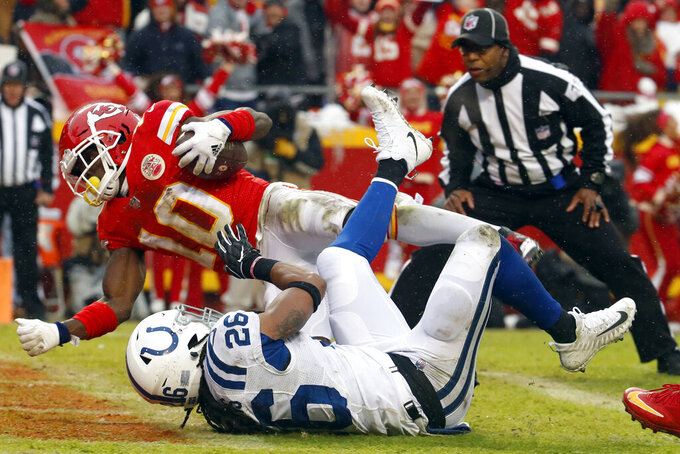Kansas City Chiefs wide receiver Tyreek Hill (10) scores a touchdown past Indianapolis Colts safety Clayton Geathers (26) during the first half of an NFL divisional football playoff game in Kansas City, Mo., Saturday, Jan. 12, 2019. (AP Photo/Charlie Riedel)