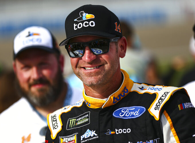 Clint Bowyer looks on before a NASCAR Cup Series auto race at the Las Vegas Motor Speedway on Sunday, Sept. 15, 2019. (AP Photo/Chase Stevens)