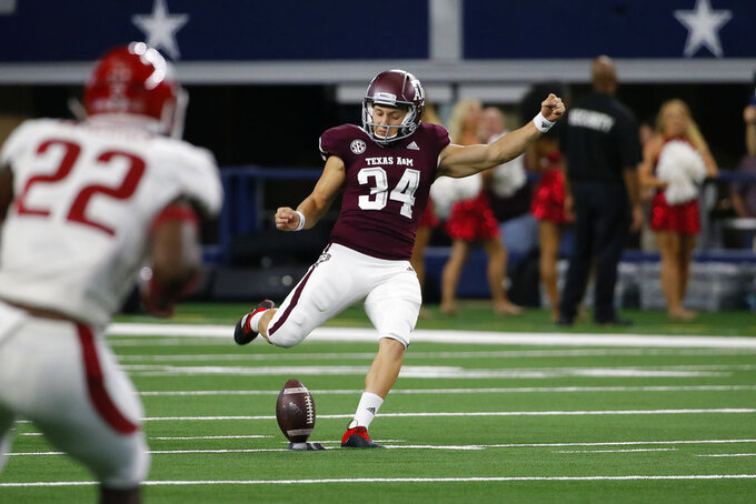 FILE - In this Sept. 29, 2018, file photo, Texas A&M kicker Braden Mann (34) kicks off during the first half of an NCAA college football game against Arkansas, in Arlington, Texas. Mann was named to The Associated Press Midseason All-America team, Tuesday, Oct. 16, 2018. (AP Photo/Roger Steinman, File)