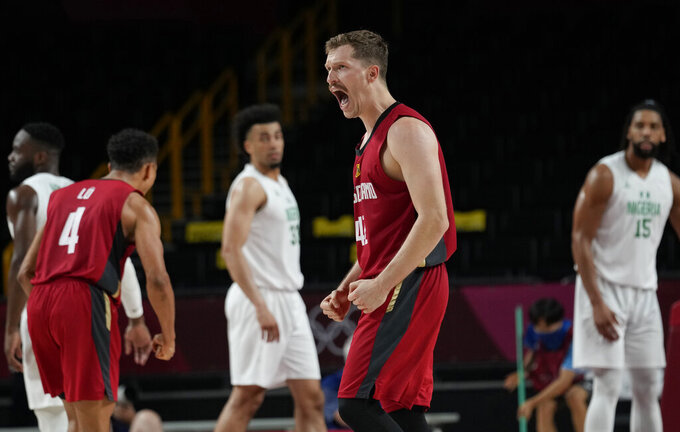 Germany's Andreas Obst (42) celebrates during men's basketball preliminary round game against Nigeria at the 2020 Summer Olympics, Wednesday, July 28, 2021, in Saitama, Japan. (AP Photo/Eric Gay)