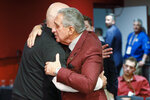 Atlanta Falcons owner Arthur Blank, right, embraces Falcons head coach Dan Quinn after an NFL football game against the Seattle Seahawks, Sunday, Oct. 27, 2019, in Atlanta. Atlanta coach Dan Quinn has been fired after the Falcons dropped to 0-5 for the first time since 1997. The move came just hours after the Falcons lost to the Carolina Panthers 23-16, Sunday, Oct. 11, 2020. The team also fired longtime general manager Thomas Dimitroff, who had been with the team since 2008. (AP Photo/John Bazemore)