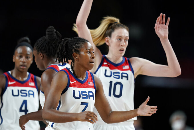 United States' Ariel Atkins (7), center, celebrates with teammates after their win in the women's basketball preliminary round game against Japan at the 2020 Summer Olympics, Friday, July 30, 2021, in Saitama, Japan. (AP Photo/Charlie Neibergall)