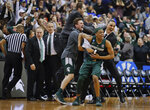 Michigan State guard Cassius Winston (5) begins to celebrate with members of his team after defeating Duke in a NCAA men's East Regional final college basketball game in Washington, Sunday, March 31, 2019. Michigan State won 68-67. (AP Photo/Alex Brandon)