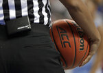 In this photo taken March 8, 2019, A Precision Time unit is shown attached to an official during the first half of an Atlantic Coast Conference women's tournament basketball game in Greensboro, N.C. The Precision Time system created more than two decades ago by former referee Mike Costabile currently is used at nearly every level of the sport, including the NBA and college basketball's NCAA Tournament. Costabile estimates the ability to stop the clock automatically on a referee's whistle can save roughly 90 seconds formerly lost to reaction time when timekeepers manually stopped the clock. (AP Photo/Chuck Burton)