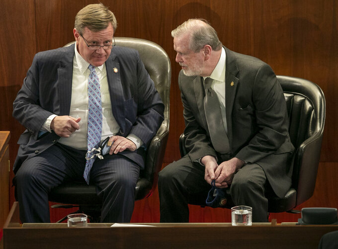 FILE - In this April 26, 2021, file photo, House Speaker Tim Moore, left, talks with Senator Phil Berger in Raleigh, N.C. The North Carolina House on Thursday, Aug. 12, 2021, approved a two-year budget with enough support to thwart a potential veto from Democratic Gov. Roy Cooper. (Robert Willett/The News & Observer via AP, File)